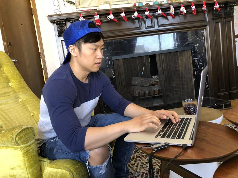 Anthony Yang checks the value of his cryptocurrency. He says he checks it a couple of times a week.
