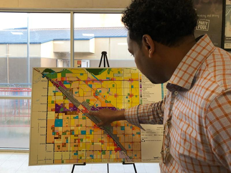 At a recent community meeting, west Fresno resident Semere Paulos points out areas on a map of Fresno that get particularly congested.