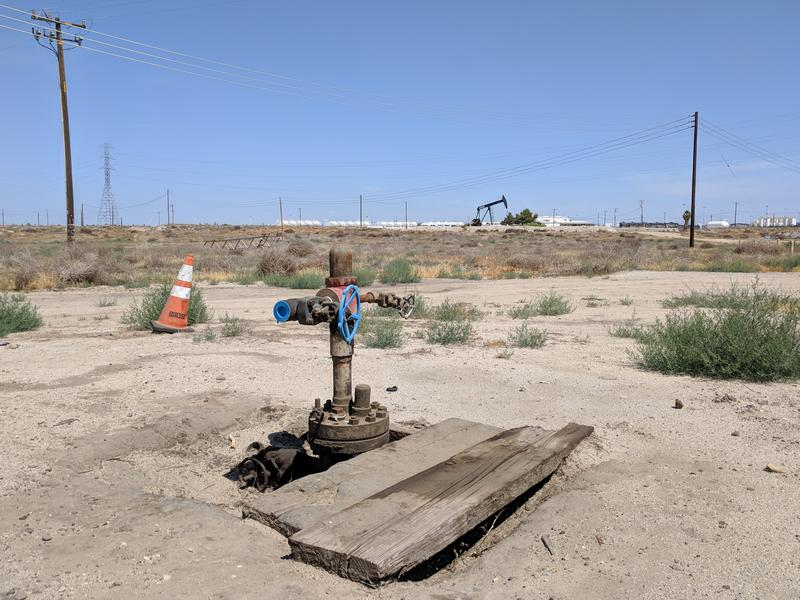 This wellhead in Kern County's Fruitvale Oilfield seals one of Californias 29,000 idle oil and gas wells. Idle wells are typically capable of producing, but for economic or technical reasons, operators may choose to keep them on reserve.