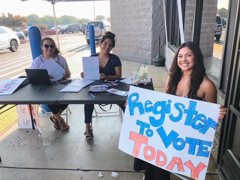 From left to right: Rosanai Paniagua, Ofelia Rojas, and Kathy Delacruz Cerros are with the Central Valley Freedom Summer project. They've spent part of their summer tabling outside of local shops like Walmart in Porterville to register new voters.