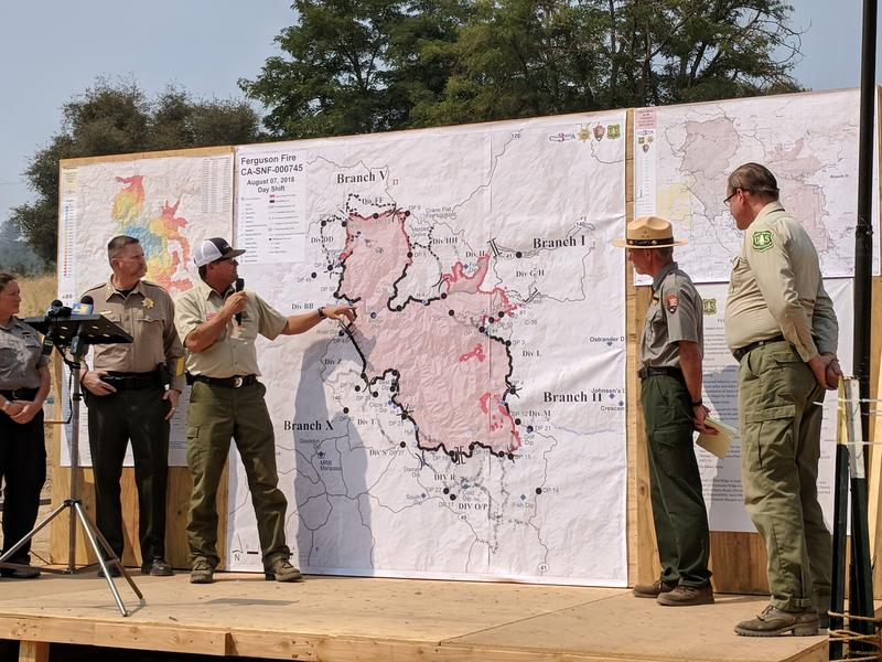 Mark vonTillow, Incident Commander of California Incident Management Team 3, shows the progress of firefighters against the Ferguson Fire during a press conference on July 7, 2018.
