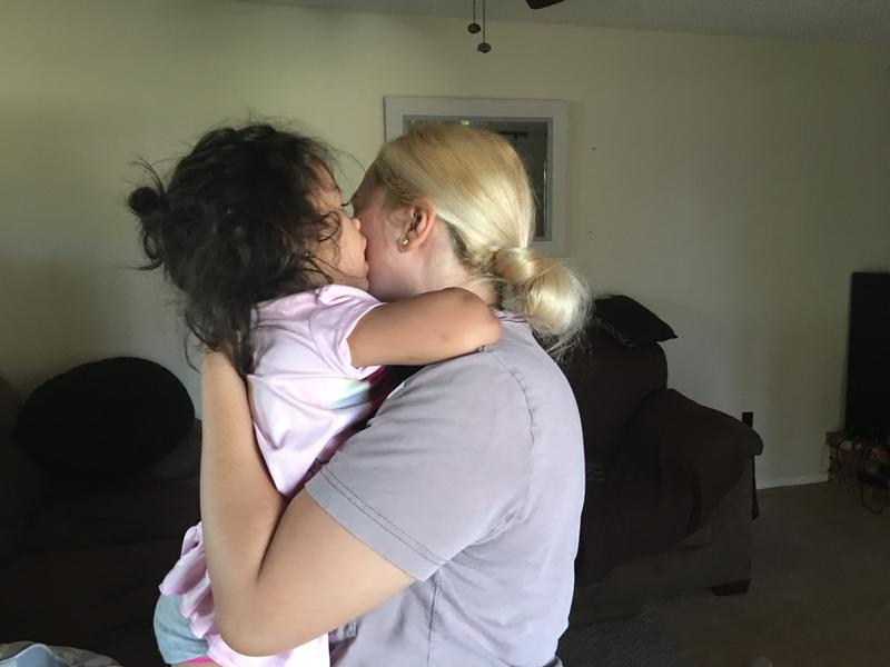 Mirsa Urias, 30, holding her 2-year-old daughter in their Bakersfield home.