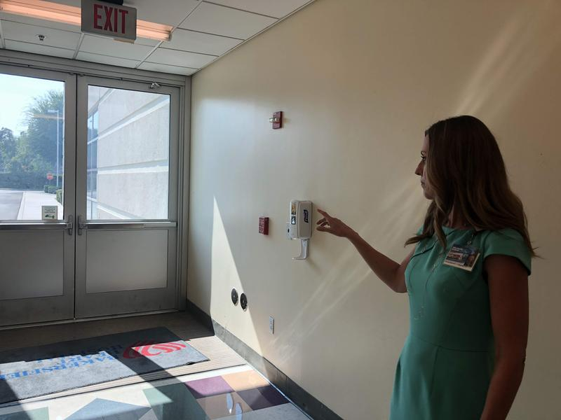 Michelle Oxford, CEO at Bakersfield Heart Hospital, shows where a gunman shot into the facility back in December of last year.