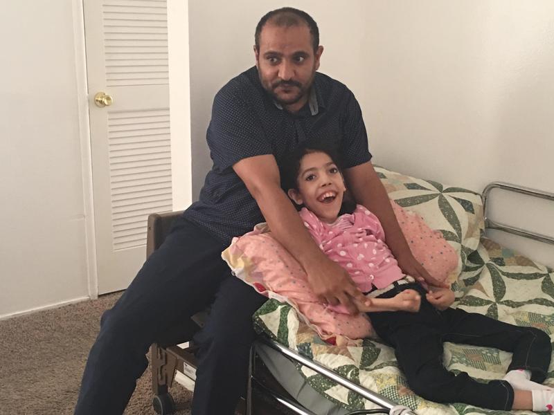 Nageeb Alomari and his 11-year-old daughter, Shaema, in their Visalia home.