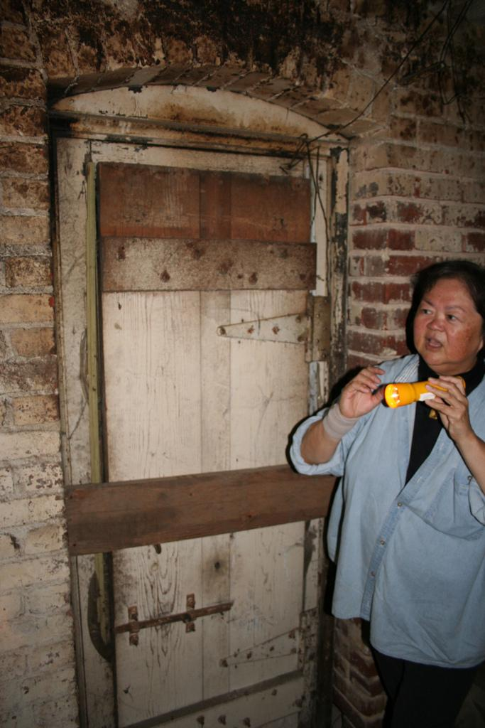 Kathy Omachi leads a tour of Fresno's underground Chinatown in 2007. She claims this door is an entrance to a tunnel.