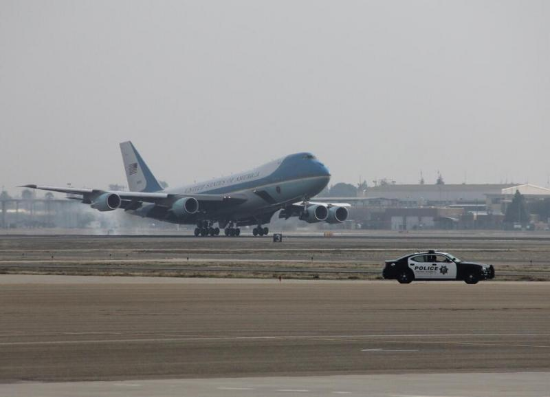 Air Force One touches down on the runway of Fresno Yosemite International Airport