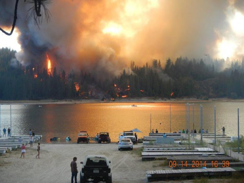 The Courtney Fire burns to the shore of Bass Lake on Sunday September 14.