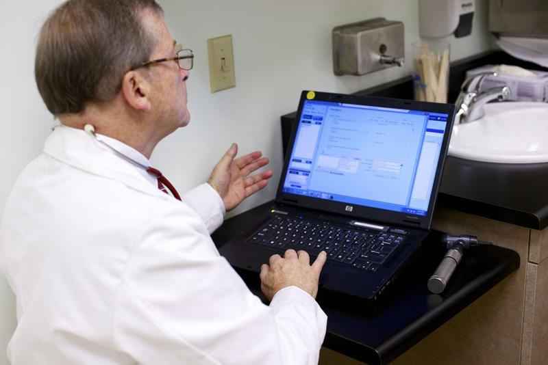 Dr. Gilbert Simon demostrates electronic health software at a Sacramento Family Medical Center.