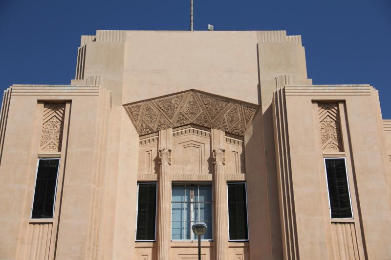 The now vacant courthouse annex in Visalia is topped by a central tower decorated with Art Deco trademark design elements.