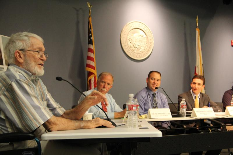 Dr. Tom Larwood talks about the history of valley fever research at a town hall meeting held in Bakersfield on Friday.