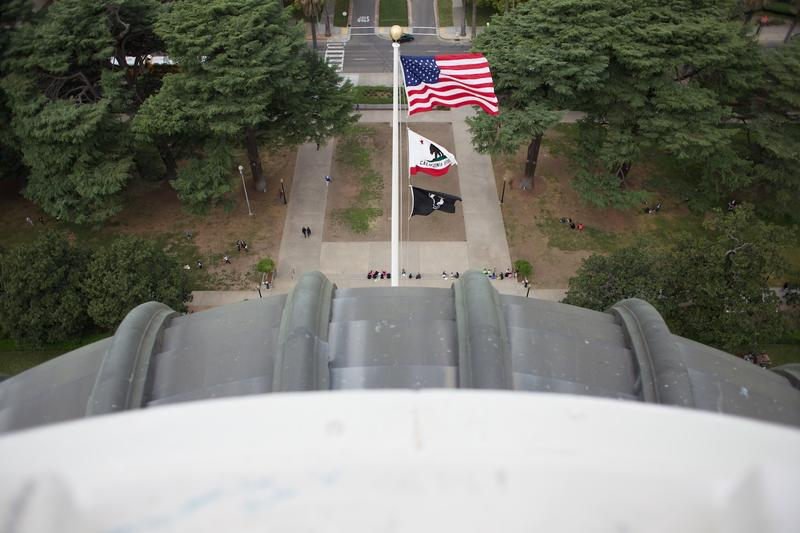 The view from the top of the Capitol dome shows a green Sacramento landscape.