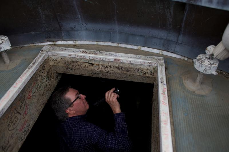 Ken Cooley points out the graffiti in the cupola at the top of the Capitol dome.