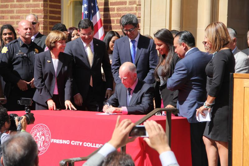 Governor Jerrry Brown signs AB60 into law at Fresno City College Thursday October 3, 2013.