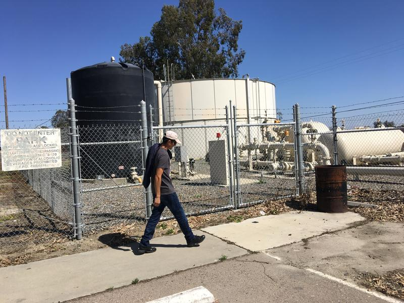 A Lanare resident walks past a water treatment plant that locals can't afford to maintain to rid their tap water of arsenic.