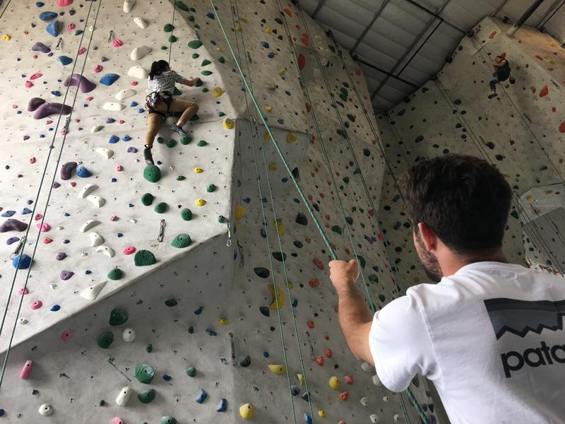 One of the best ways to learn how to rock climb is to practice at a climbing gym.