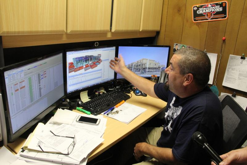 An employee of California TrusFrame demonstrates the sotware that they use to design the individual wall units.