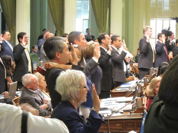 Lawmakers take their oath of office at the capitol on Monday