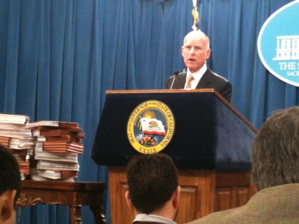 Gov. Jerry Brown announces an end to the state of emergency in California's prison system at a Capitol news conference Tuesday in Sacramento.