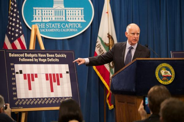 California Governor Jerry Brown is calling for another year of fiscal prudence, despite the state's $4.6 billion budget surplus. That's drawing mixed reactions from legislative Democrats and cautious praise from minority Republicans.