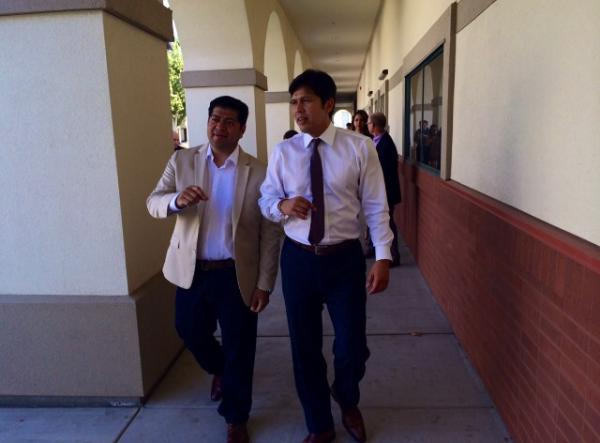 During his trip to the Central Valley, Kevin de Leon, right, takes a tour of Roosevelt High School with Luis Chavez, a Fresno Unified Board Member.