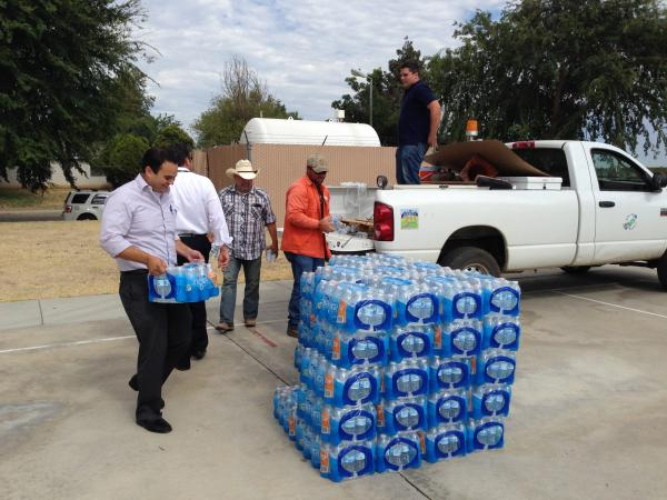 Home Depot donated cases of water to the community.