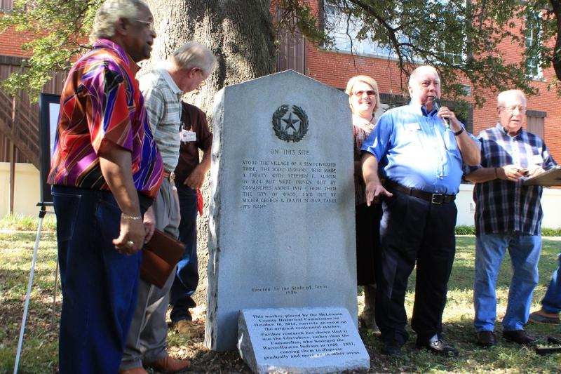 David Brittain and other members of the McLennan County Historical Commission stand in front of new marker.