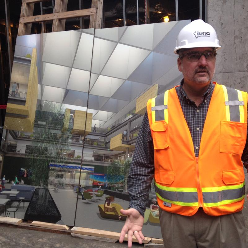 Brian Hausam, project manager with Flintco, in the atrium of the Paul L. Foster Campus construction site.