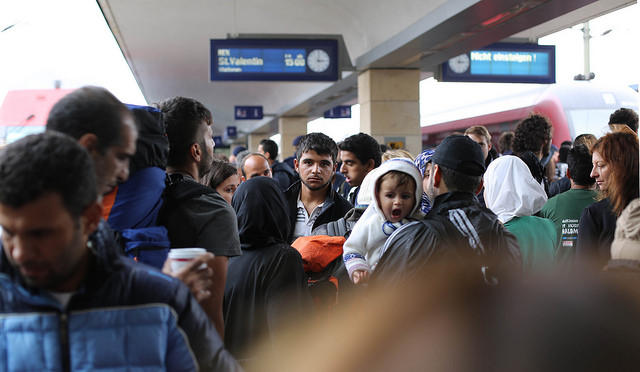 Syrian refugees in Vienna waiting for a train