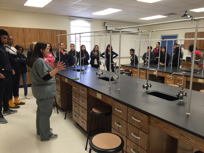 GWACHA Assistant Director Krystal Wilson gives a tour to visitng students from La Vega High School