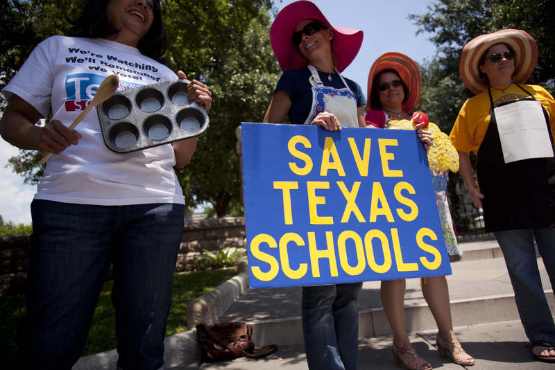 Public-school activists hold an ironic expensive bake sale outside the Texas Capitol in 2012.
