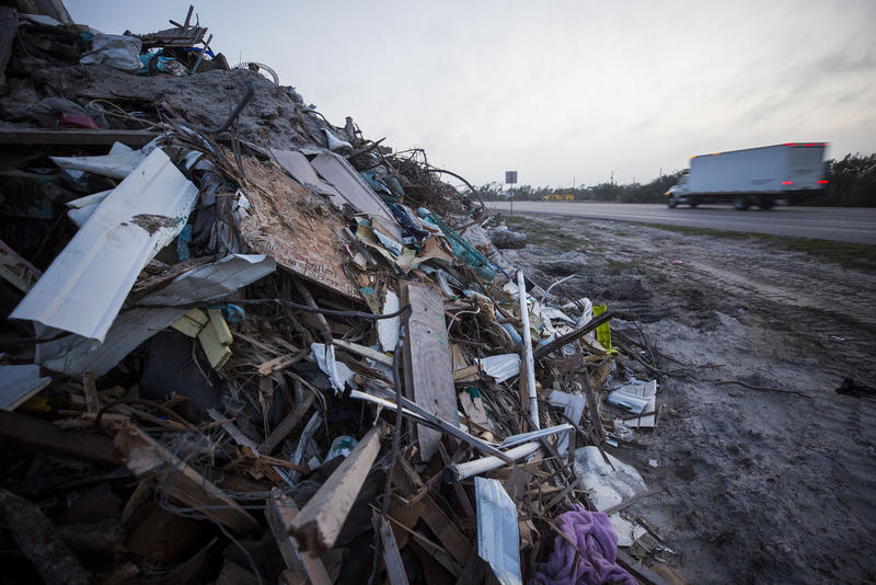 A two-mile long stretch of debris piles along Highway 35 from cleanup efforts across the Live Oak Peninsula. Recovery efforts continue six months after Hurricane Harvey hit Texas' Coastal Bend.