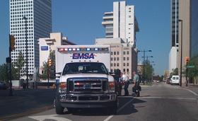 An EMSA Ambulance on an emergency call in downtown Tulsa.