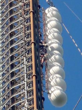 Tower climber is next to the Public Radio Tulsa main and emergency antennas