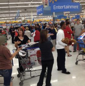 Long lines at the Electronic Center at Owasso's Wal-Mart last night.