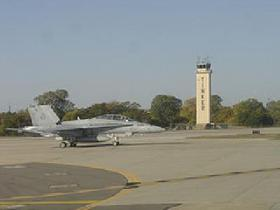 A military jet readies for take-off from the Tinker AFB