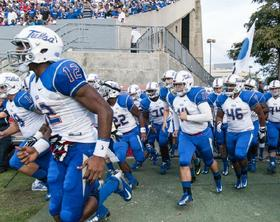 The Golden Hurricane run onto the field at Houston.