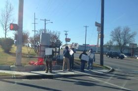 Strikers hold signs and wave to passersby in front of the Tulsa Hostess factory at 11th and Sheridan.