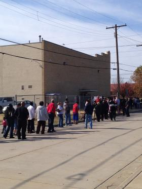 Long lines for Thanksgiving meals outside John 3:16.