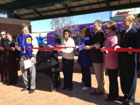 Esther Ogans, Chair of the Lacy Park Task Force, cuts the ribbon on the new bus shelter, along with Mayor Bartlett and other city leaders.