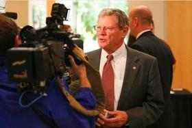 Jim Inhofe talks with reporters