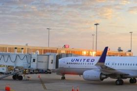 A United Airline jet parked on the tarmac at Tulsa International