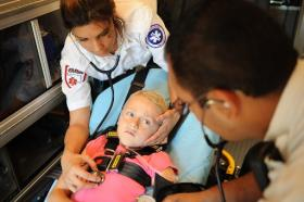 EMSA paramedics take care of a young child.