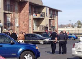 Tulsa Police begin their investigation at the Fairmont Terrace apartments where four women were shot to death.