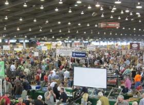 File photo of people attending a gun show at the Tulsa Fair Grounds in November of 2011