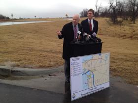 Mayor Bartlett looks on as State Transportation Secretary Gary Ridley speaks about the Gilcrease Expressway, visible behind them.