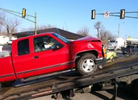 A pickup is loaded onto a wrecker after colliding with a Tulsa Transit Bus