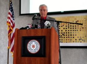 Cherokee Chief Bill John Baker makes the announcement to reporters this afternoon.