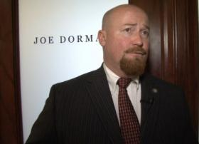 Joe Dorman talks with media outside of his office at the capitol.