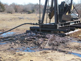 An oil drilling site near Skiatook Lake leaks on the surface.