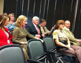 Sheriff Glanz and family listen as a new law enforcement training center is named for him